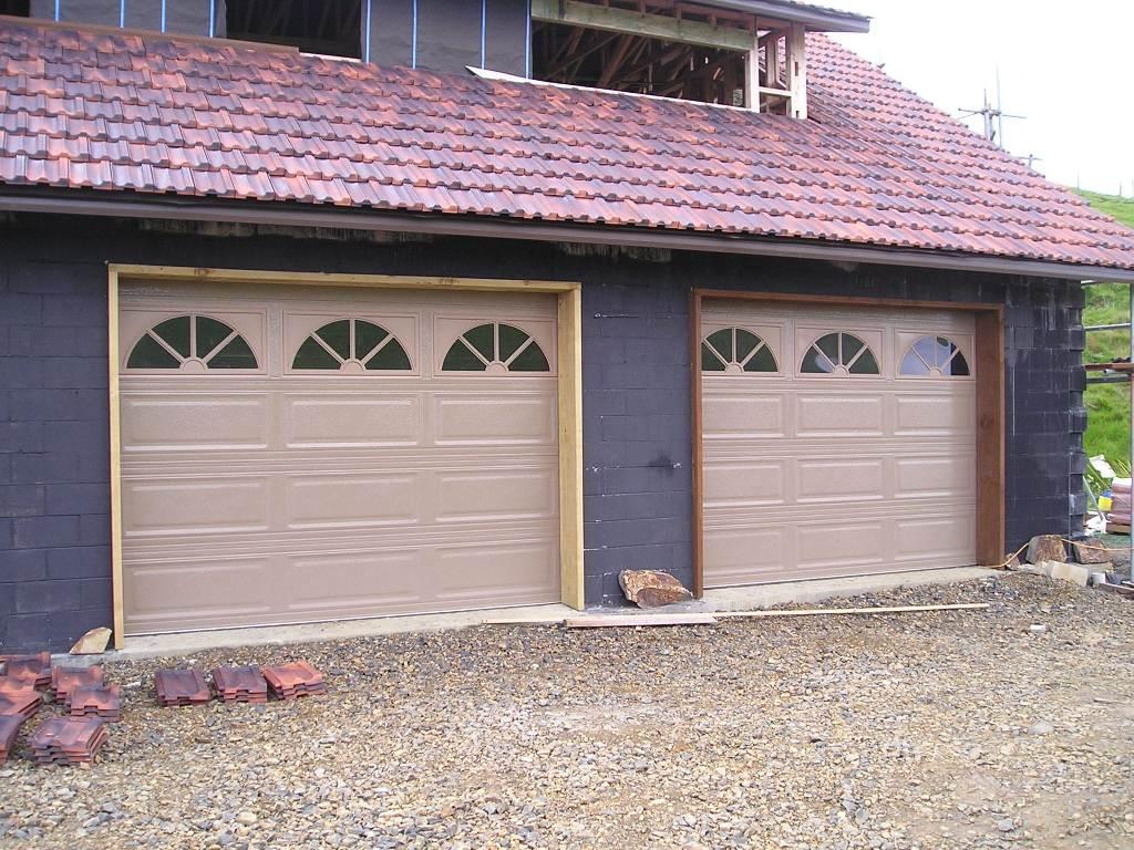 Garage Doors. Raised Panel With Sunburst Window