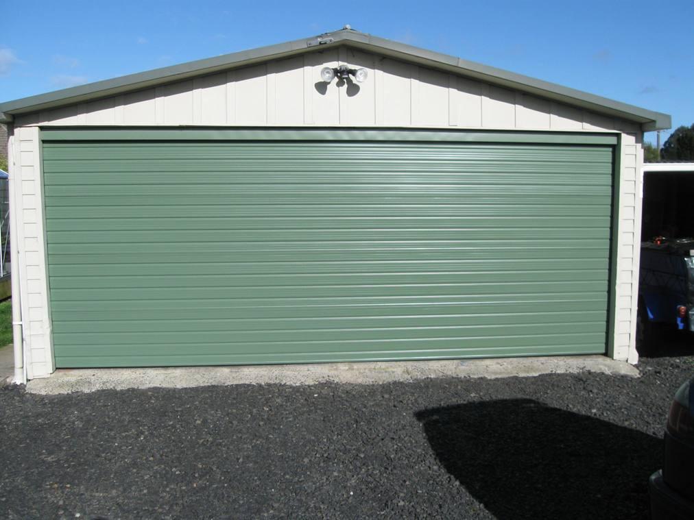 Nightingale garage doors and gates garage doors steel for Garage fence